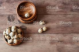 rustic wooden bowls wooden bowls with quail eggs rustic wood background diffused natural light a diffe rustic wooden bowls