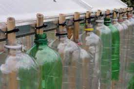 cut the base out of each bottle to allow for stacking and attach the top and bottom bottles of each column with a cable tie