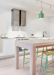 fresh kitchen designs. minimal design elements combine w/ a large table \u0026 green stools, in this modern kitchen design. fresh designs s
