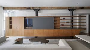 office of architecture swaps walls for walnut furniture in tribeca apartment new p63 furniture