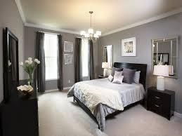 black classic bedstead light grey mattress dark brown bedside table white classic bedside lamp black dresser chandelier light grey wall white rose glass