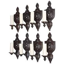 rare set of eight 1920 cast iron sconces four are sold