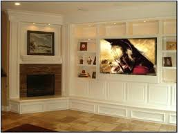 corner fireplace design with built in entertainment center and bookcase construction now how i like a