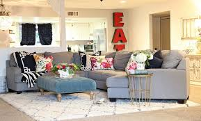 rug on carpet ideas area rug over carpet in living room living room ideas