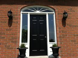 outstanding black wooden 6 panel single modern front door with white double clear gl entry windowed and brick wall facade exposed with pair wall light