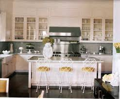 image of cream kitchen cabinets with dark floors