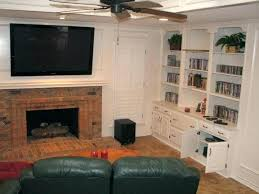 mount above fireplace drawers over large me mounted on brick wall hang tv installing