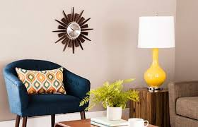 A Blue Chair And Yellow Lamp Add A Pop Of Color To This Mid Century