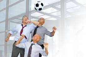 Businessmen Playing Soccer In The Office Stock Photo Picture And