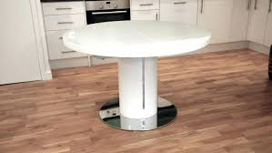 tables for small spaces that expand expandable round pedestal dining table extendable india sp