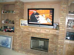 mounting a tv over fireplace mounting above brick fireplace hiding wires beautiful decoration also add over