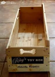 the dog bone cutouts on this puppy toy box make it easy to slide or lift