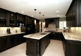 brown cabinets white kitchen with granite countertops grey walls gray
