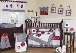 interior black and white strawberry crib bedding on