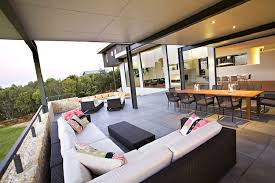 trend design furniture. openspace trend design l sectional sofa in white and multiple colors pillows black rattan coffee table furniture
