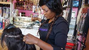lillian anderson sewing in a weave at her salon extensions plus in minneapolis photo by urmila ramakrishnan
