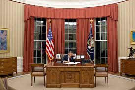 desk oval office. in this handout image provided by the white house president barack obama edits his remarks desk oval office