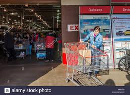 fairfax usa people shopping carts filled fairfax usa 3 2016 people shopping carts filled groceries walking out of costco store in virginia