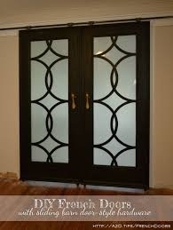 diy french doors with circle fretwork panels installed in inexpensive diy barn door hardware