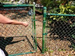 chain link fence post. Slide The Gate Away From Fence Post Set It Aside. Chain Link