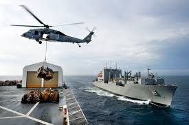 u s department of defense photo essay lewis and clark during a an mh 60s knight hawk helicopter transports cargo from the usns comfort to the usns