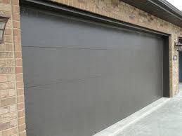 flat panel garage doorCONTEMPORARY FLAT PANEL garagedoors  Custom Homes by Tompkins