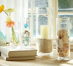 summer decoration ideas with glass vase fillers and white curtains