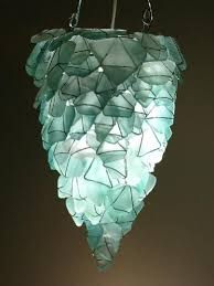 chandelier from sea glass how pretty is this aqua shard subdued lighting