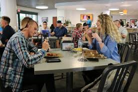 students eating dinner at round table