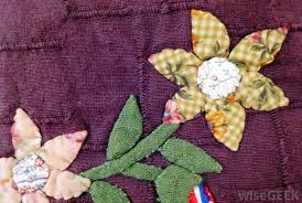 How Do I Make an Applique Quilt? (with pictures) & Appliques can be attached either with iron-on or sewing methods. Adamdwight.com
