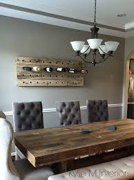 benjamin moore rockport gray is a nice paint color for any room shown here with rustic dining table and wine bottle holder and crown moulding in dining