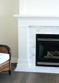 fireplace casing fireplace with white painted mantel and marble subway tile surround satori design for living