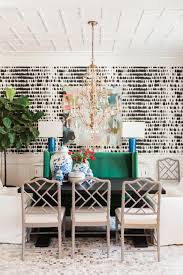 in this eclectic dining room from kendall simmons bold black and white wallpaper bees a chic backdrop for gold accents and vibrant furniture