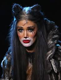 in character delta s ensemble was equally impressive wearing a grungy fur coat teamed with cats al makeup rumpleteazer