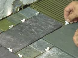 use spacers to achieve consistency between tiles