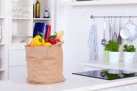 Kitchen counter with food Chefs Preparing Paper Shopping Bag Full Of Food On Kitchen Counter Stock Photo 18345833 Amazon Uk Paper Shopping Bag Full Of Food On Kitchen Counter Stock Photo