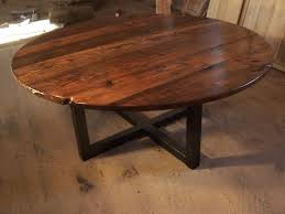 a hand crafted large round coffee table with industrial metal base made to order from the strong oaks wood custommade com