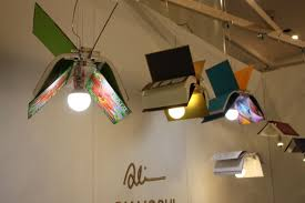 into lighting. Here, He Has Reimagined Colorful Books As Lights In Flight Across The Top Of Your Into Lighting