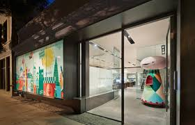 creative office designs. design view in gallery office entrance greets workers with a peculiar life sized figurine that echoes the color scheme of creative designs m