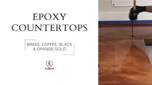 epoxy countertop coating in br coffee black and orange gold metallics