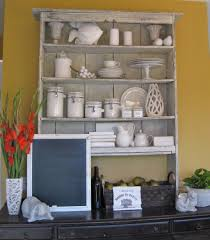 reclaimed wood kitchen buffets and hutch featuring graded open shelving and shiplap wooden backsplash