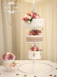 pink rose hanging wedding cake by gifted heart cakes