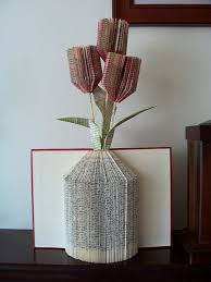 book folding art book with red and white hard covers opened to reveal a