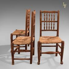 Harlequin Set Of 7 Antique Spindle Back Dining Chairs Lancashire
