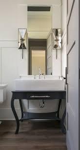24 inch corner bathroom vanity more see more urban electric co chic powder room sconces charleston southcarolina danielisland custom