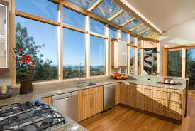kitchen design apply feng shui principals used in airy kitchen with wooden cabinets and