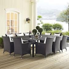 khadar 11 piece dining set with cushion