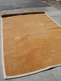 this sisal rug had seen better days