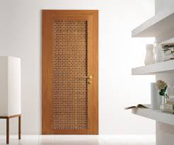 Interior House Doors Designs Modern Interior Swing Door Featuring A Cherry Wood Lattice Hinged