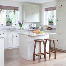 small kitchen island. Small Kitchen Island Wood Table Appealing Narrow Black Chair Double Stove Cabinet Doors Knobs Ceramic Tile Backsplash Jars Bottle Bowl Plate Dark T